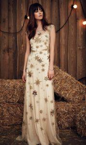 tan dress with unique star applique
