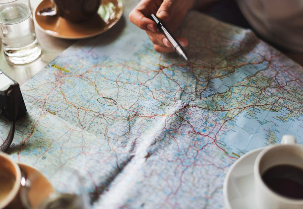 Person planning travel with a map